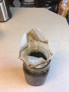 cold brew coffee in canning jar with filter folded up